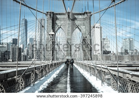 NEW YORK - CIRCA FEBRUARY 2015: Pedestrians are crossing the Brooklyn Bridge in winter of 2015. Spring has been slow to come to New York in 2016.