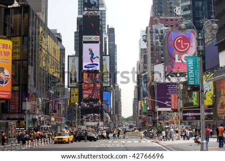 NEW YORK - CIRCA JULY 2008: Crowds walk by at New York Times Square traffic area circa July 2008 in New York. - stock photo