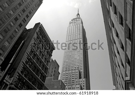 NEW YORK - CIRCA JULY 2009: The Empire State Building circa July 2009 in New York City, USA. After the terrorist attack on 9/11/01, this is the tallest building in New York and 3rd in USA. - stock photo