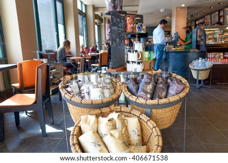 NEW YORK - CIRCA MARCH 2016: inside of Starbucks Cafe. Starbucks Corporation is an American global coffee company and coffeehouse chain based in Seattle, Washington - stock photo