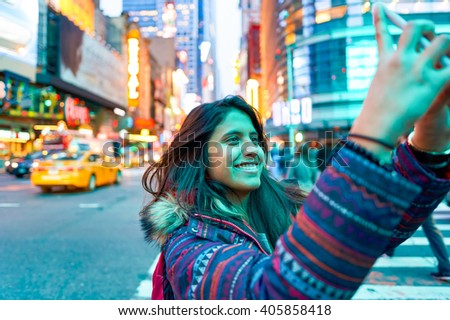 NEW-YORK - CIRCA MARCH 2016: woman taking a selfie in Manhattan at evening. Manhattan is the most densely populated borough of New York City