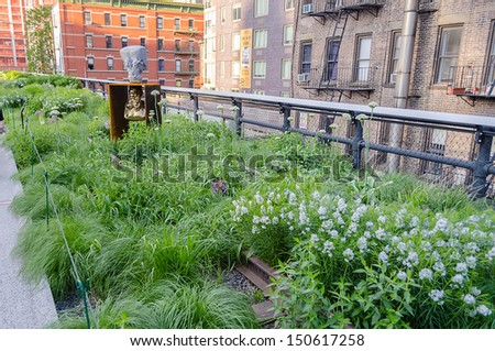 NEW YORK - CIRCA MAY 2013: The High Line Park, New York, circa May 2013. The High Line is a popular linear park built on the elevated train tracks above Tenth Ave in New York City. - stock photo