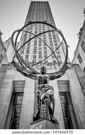 NEW YORK - CIRCA MAY 2013:: The historic Atlas Statue in the Rockefeller Center, New York, circa May 2013. It stands for power in the 5th Ave where is located the most expensive retail stores of NYC. - stock photo