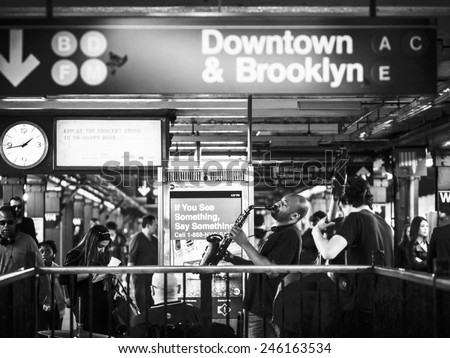 New York CIRCA OCT 2014 - saxophonist plays jazz music in the subway station in NYC.  - stock photo