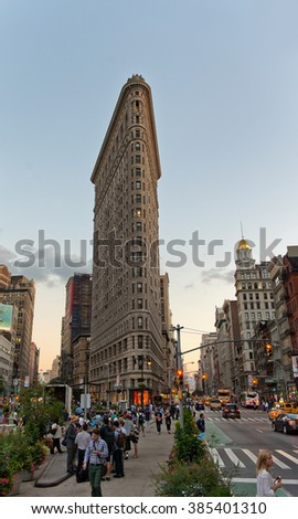 NEW YORK - CIRCA SEPTEMBER 2015: Bustling Pedestrians and Traffic on Fifth Avenue by Historic Flatiron Building at Dusk in Manhattan, New York City, New York, USA - stock photo