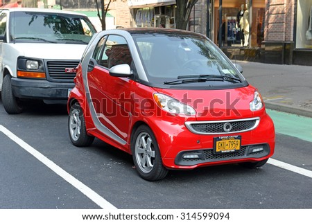NEW YORK - CIRCA SEPTEMBER 2015. In a city such as Manhattan where space is limited, the tiny Smart car has increased in popularity, especially the electric model which appeals to the â??greenâ?� minded.