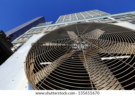 NEW YORK - CIRCA 2011: Wide angle view of an outdoor HVAC air conditioner unit located on a high-floor porch of a midtown Manhattan skyscraper, NY on Circa 2011. - stock photo