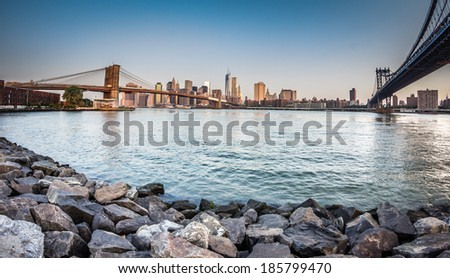 New york citiscape in the morning with brooklyn bridge - stock photo