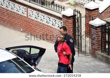 NEW YORK CITY - APRIL 23 2015: a Sunset Park, Brooklyn, man was arrested & taken into custody by NYPD officers after repeatedly violating an order of protection by approaching his ex-wife - stock photo