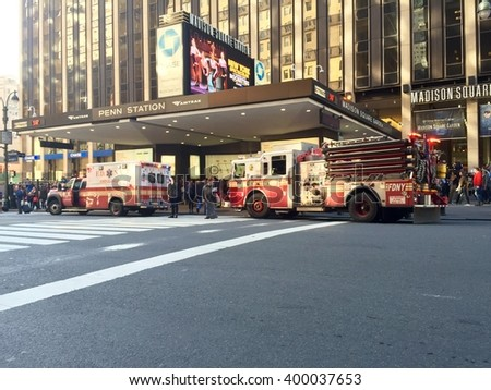 New York City - April 1, 2016: Breaking News - FDNY fire engine and ambulance sit outside Penn Station responding to an emergency situation in the Amtrak waiting area.
