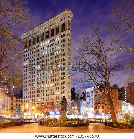 NEW YORK CITY - APRIL 15: Flatiron Building April 15, 2013 in New York, NY. Finished in 1902, the landmark skyscraper was designated a City Landmark in 1966 and a National Historic Landmark in 1989. - stock photo