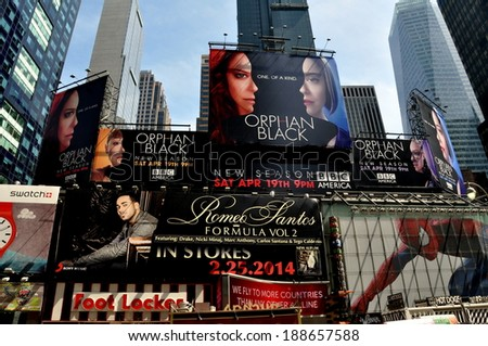 New York City - April 19, 2014: Giant advertising billboards cover building facades overlooking legendary Times Square - stock photo