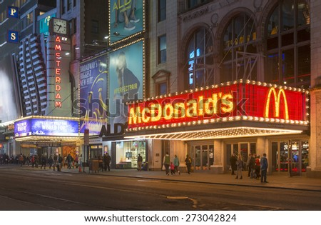 NEW YORK CITY - APRIL 20: McDonaldâ??s neon sign on 42nd street on April 20, 2015 in New York City.  - stock photo