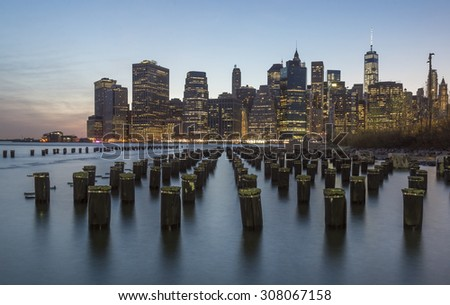 NEW YORK CITY - APRIL 18: New York City Manhattan skyline with One World Trade Center over East River on April 18, 2015 in New York City.  - stock photo