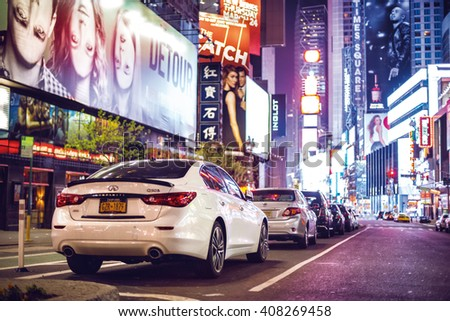NEW YORK CITY - APRIL 18: Nighttime in Times Square features with car parking city lights in New York City on April 18, 2016 in Manhattan, New York City. - stock photo