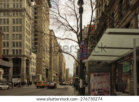 New York City - April 26 - People and traffic make their way down 5th Avenue in Midtown Manhattan on April 26, 2015. - stock photo