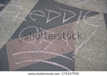 """NEW YORK CITY - APRIL 30 2015: several dozen activists staged a """"block party"""" at One Police Plaza to protest the """"broken windows"""" philosophy of law enforcement. Freddie Gray in chalk - stock photo"""