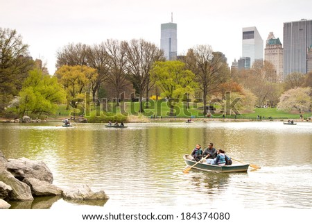 NEW YORK CITY - APRIL 22: Some unidentified people relaxing in Central Park, one of the most touristic places in Manhattan, on April 22, 2011, in New York City, USA. - stock photo