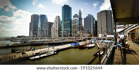 NEW YORK CITY - APRIL 26: The historic Peking schooner with the modern office buildings of Lower Manhattan at South Street Seaport on April 26, 2011 in New York, NY. - stock photo
