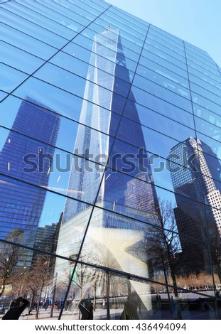 New York City - april 15: The One World Trade Center and memorial site in New York with blue sky on April 15, 2016 - stock photo