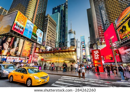 NEW YORK CITY - APRIL 9, 2013: Times Square crowds and traffic at dusk.The site is regarded as one of the world's most visited tourist attraction. - stock photo