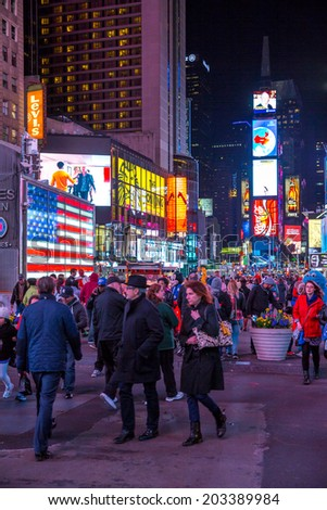 New York City -April 8: Times Square, featured with Broadway Theaters and animated LED signs, is a symbol of New York City and the United States, April 8, 2014 in Manhattan, New York City. - stock photo