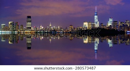 New York City at night panorama with urban architectures and reflections