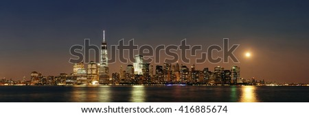 New York City at night with urban architectures with moon
