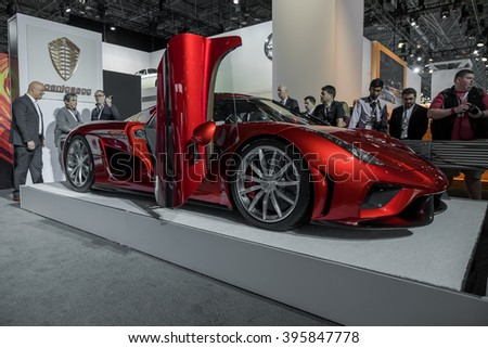 New York City - 3/25/16 - At the New York International Auto Show, Koenigsegg displays it's new Regera. Front side view with company founder Christian von Koenigsegg seen in the background. - stock photo