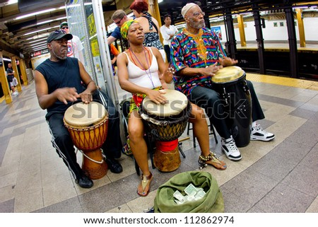 NEW YORK CITY - AUG 29:  Music Under New York African hand-drummers perform in Penn Station, NYC on Aug. 29, 2012.  MUNY has been presenting music to commuters of NYC public transit since 1985. - stock photo