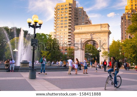 NEW YORK CITY - AUG 15:  Summer evening at Washington Square Park in Manhattan on Aug 15, 2013.  Washington Square Park is a 9.75 acre park located in Greenwich Village and is a popular meeting spot. - stock photo