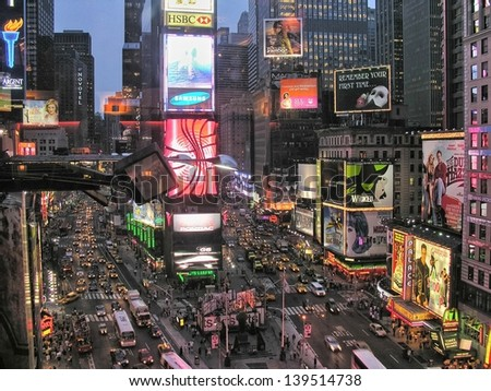NEW YORK CITY - AUG 11: Times Square ,is a busy tourist intersection of neon art and commerce and is an iconic street of New York City and America, August 11, 2007 in Manhattan, New York City - stock photo