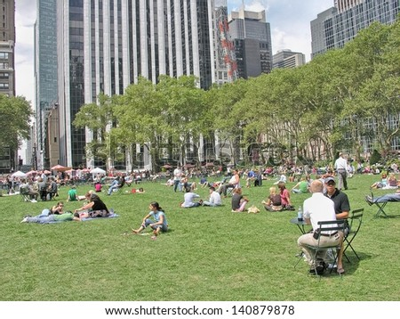 NEW YORK CITY - AUG 14: Tourists relax in Bryant Park, August 14, 2008 in New York City. More than 50 million people visit the city every year. - stock photo