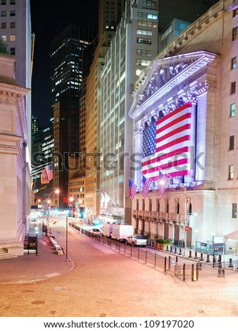 NEW YORK CITY - AUG 8: Wall Street New York Stock Exchange, the world's largest stock exchange by market capitalization of its listed companies, at night. August 8, 2010 in Manhattan, New York City. - stock photo