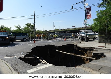 NEW YORK CITY - AUGUST 4 2015: a massive sinkhole erupted in the Sunset Park neighborhood of Brooklyn, closing several streets & bringing FDNY, OEM & DEP, Con Ed & National Grid. - stock photo