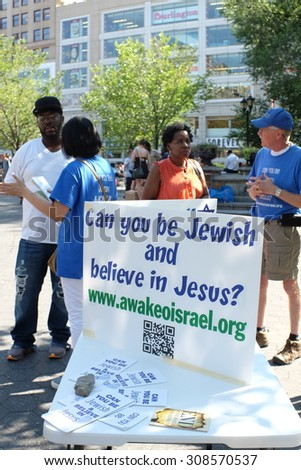 NEW YORK CITY - AUGUST 21 2015: Awake O Israel members, a Philadelphia-based Messianic congregation, persuades passersby at Union Square Park that belief in Jesus is consistent with Jewish tradition