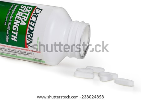 NEW YORK CITY - AUGUST 13, 2014:  Bottle of Excedrin Extra Strength aspirin and tablets against white.  This over the counter pain reliever is one of the top selling brands of its kind in the USA. - stock photo