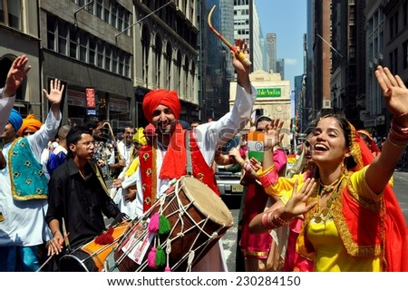 New York City - August 15, 2009:  Exuberant drummers and dancers marching in the annual India Day Parade on Madison Avenue