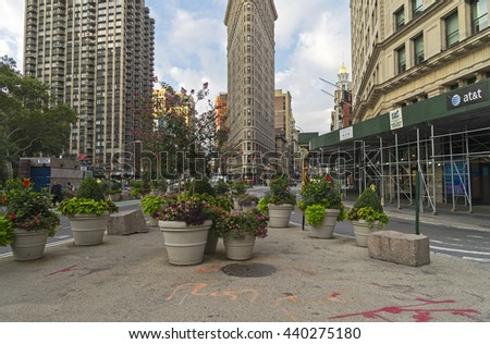 NEW YORK CITY - AUGUST 23, 2015: Flat Iron building at the intersection of Broadway and Fifth Avenue. The early morning. Manhattan, New York City. - stock photo