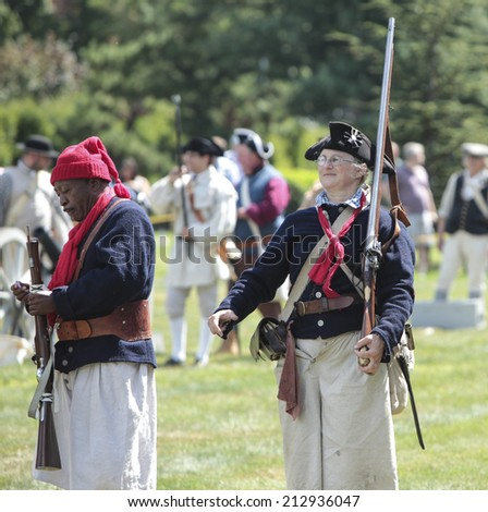NEW YORK CITY - AUGUST 24 2014: Green-Wood Historic Fund sponsored a reenactment of the Battle of Brooklyn at Greenwood Cemetery, Brooklyn, with demonstrations of musketry, cannon fire & horsemanship