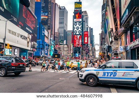 NEW YORK CITY - AUGUST 16, 2016: People on Times Square. Times Square is a major commercial intersection and neighborhood in Midtown Manhattan, New York City
