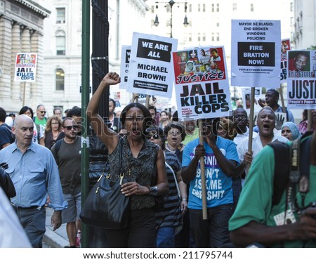 NEW YORK CITY - AUGUST 18 2014: Peoples Power Assembly staged an emergency rally at 1 Police Plaza before marching to City Hall seeking justice for Eric Garner, Michael Brown & others killed by police - stock photo