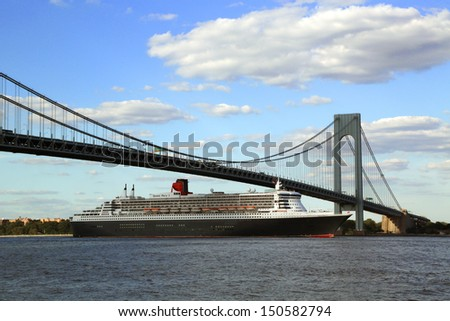NEW YORK CITY - AUGUST 15: Queen Mary 2 cruise ship in New York Harbor under Verrazano Bridge heading for Transatlantic Crossing from New York to Southampton on August 15, 2013  - stock photo