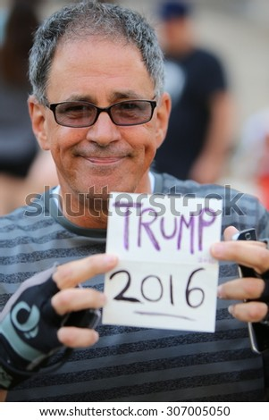 NEW YORK CITY - AUGUST 17 2015: Republican presidential nomination front runner Donald Trump arrived at 60 Centre Street for his stint at jury duty in Manhattan's supreme court. Supporter Joe Lapore - stock photo