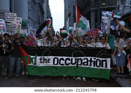 NEW YORK CITY - AUGUST 20 2014: Solidarity with Palestine hosted a rally at Cadman Plaza, Brooklyn followed by a march in sympathy with Gaza across the Brooklyn Bridge & assembly at One Police Plaza - stock photo