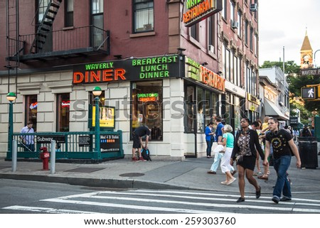 NEW YORK CITY - AUGUST 15, 2014:  Street scene in the West Village in Manhattan at Waverly Place.  - stock photo
