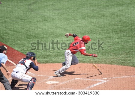 NEW YORK CITY - AUGUST 2 2015: the Brooklyn Cyclones hosted the Batavia Muckdogs at MCU stadium in Coney Island. Muckdogs Yuniel Ramirez runs for first base