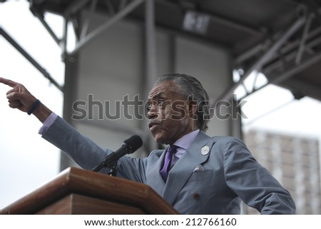 NEW YORK CITY - AUGUST 23 2014: thousands rallied in Staten Island demanding justice & accountability in the deaths of Eric Garner, Michael Brown & other victims of alleged police brutality