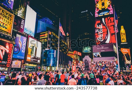 NEW YORK CITY - AUGUST 24, 2014:  Times Square at night in  Midtown Manhattan, New York on August 24, 2014. Times Square is a major intersection and tourist area in NYC. - stock photo