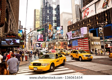 NEW YORK CITY - AUGUST 22: Times Square featured with Broadway Theaters and animated LED signs is a symbol of New York City and the United States, August 22, 2012 in Manhattan, New York City. - stock photo